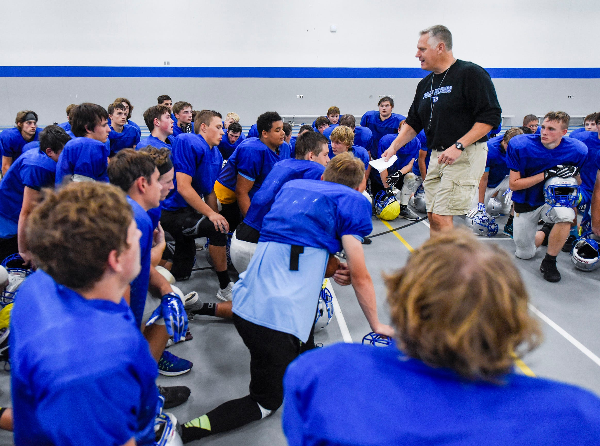 Foley coach Dave Dahlstrom talks with players during a break Monday, Aug. 20, at the Foley High School.