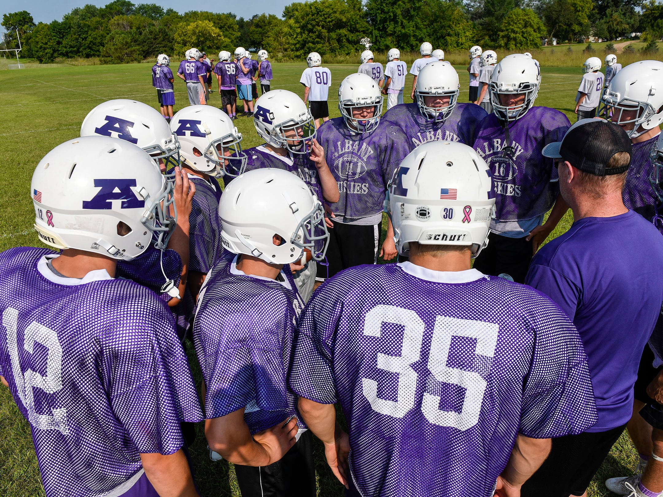 Albany players huddle before a play during practice Wednesday, Aug. 15, at the Albany High School.