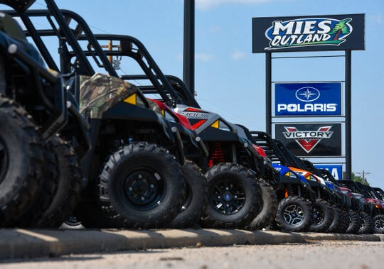 ATVs line the parking lot at Mies Outland  Wednesday, Aug. 22, at 3653-32nd St. SE in St. Cloud.