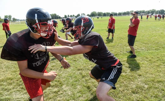 Players face off during practice Thursday, Aug. 16, at Rocori High School in Cold Spring.