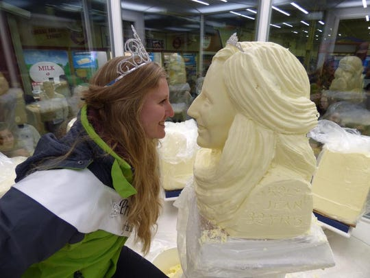 Last year's Princess Kay winner, Emily Annexstad, with her butter sculpture at the 2017 Minnesota State Fair.
