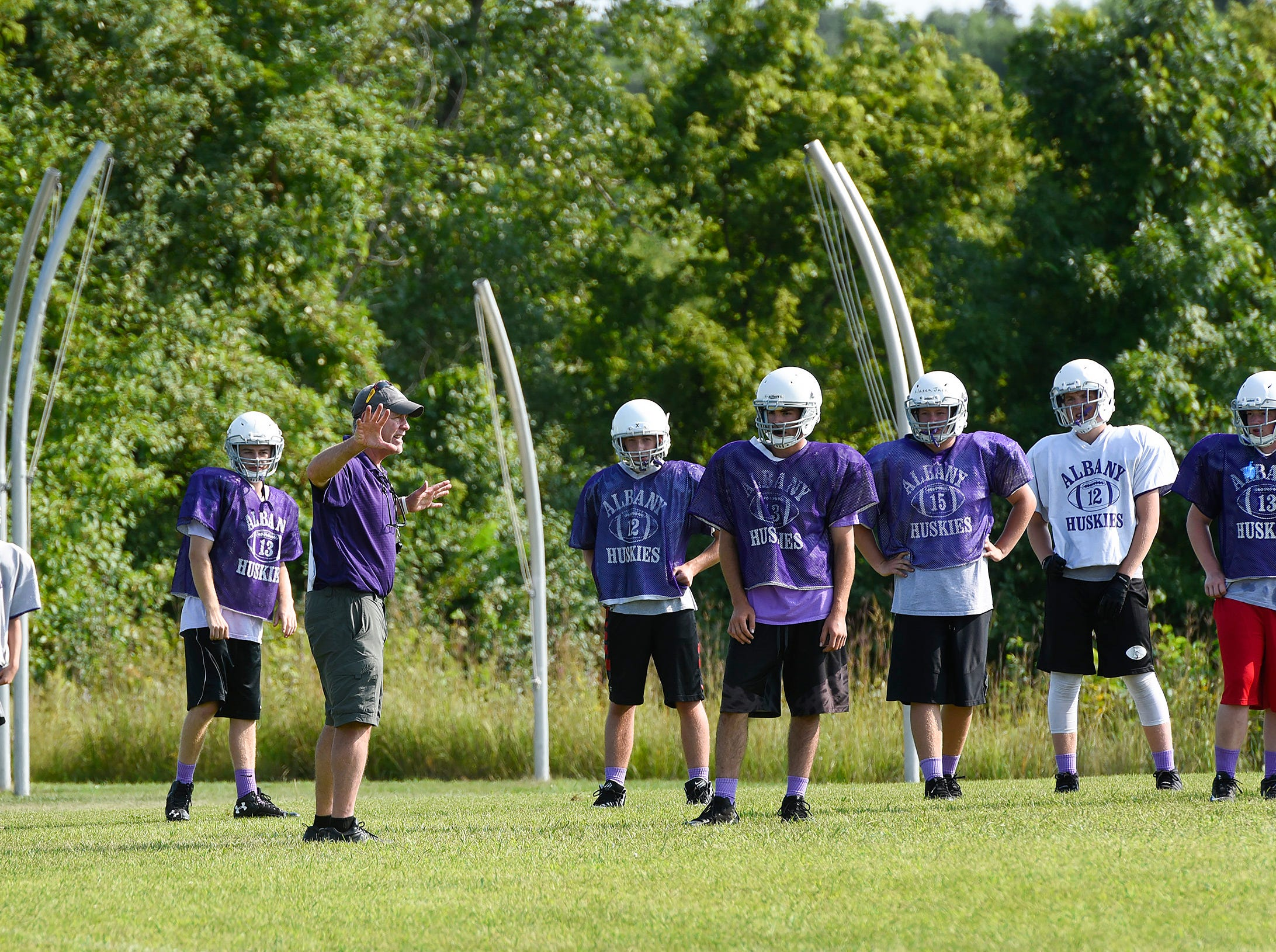 Albany coach Mike Kleinschmidt works with players during practice Wednesday, Aug. 15, at the Albany High School.
