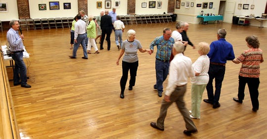 The Tallahassee Senior Center hosts square dancing at the Old Armory. The floors were once used for roller skating.