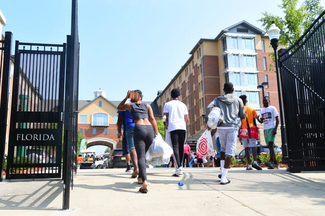 Incoming freshman and their families begin moving into the dorms at Florida A&M University on Thursday.