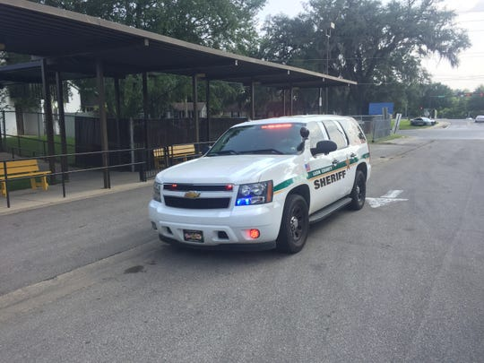 LCSO vehicle speeds to scene of Thursday afternoon shooting.