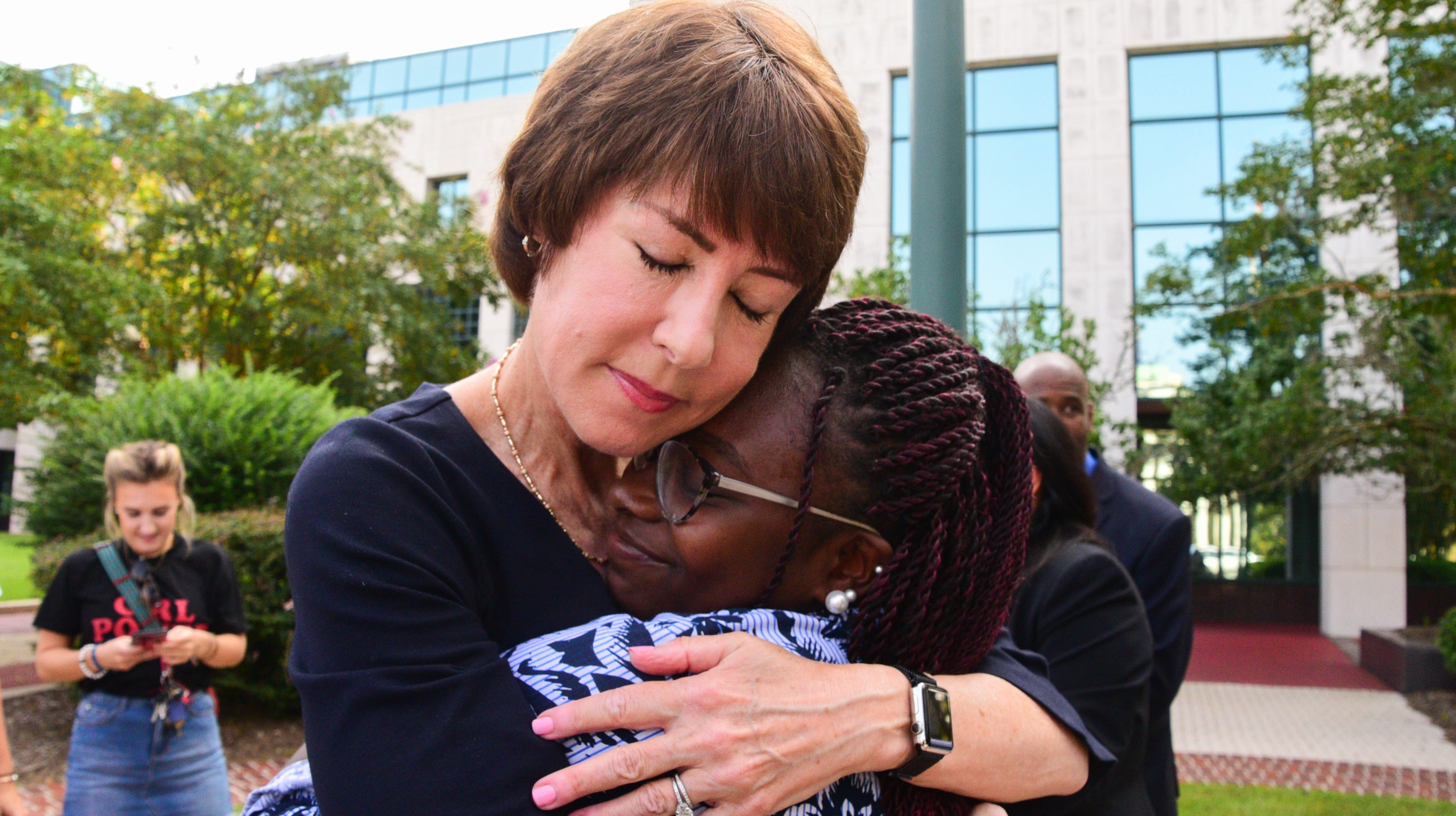 Florida democratic gubernational candidate Gwen Graham embraces supporters outside of the Leon County Courthouse on Thursday.