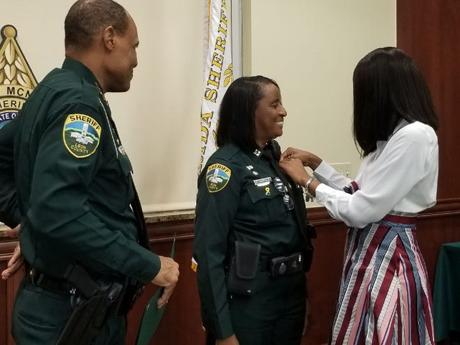 During a promotions ceremony Aug. 23, Lt. Diane Sheffield became the first black female captain at the Leon County Sheriff's Office Detention Center. Her daughter, Crystal Sheffield, pinned her badge during the ceremony.