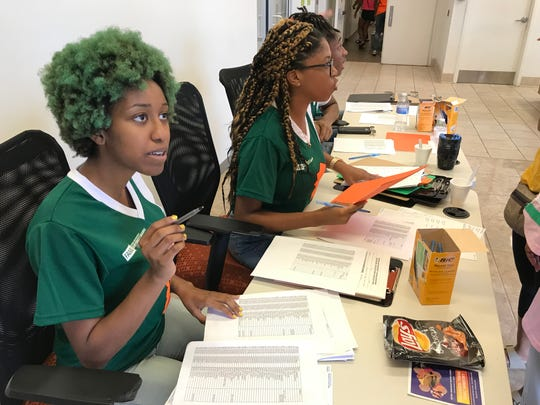 Maya Porter, a second-year public relations major and resident assistant, works with freshmen Thursday at Florida A&M University.