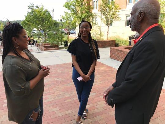 Incoming freshman Courtney Felder, center, and her mother, Desiree Felder, left, greet FAMU President Larry Robinson during move-in day Thursday at Florida A&M University.