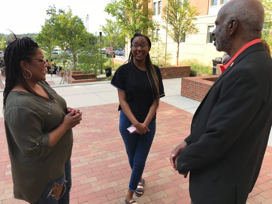 Incoming freshman Courtney Felder, center, and her mother, Desiree Felder, left, greet FAMU President Larry Robinson during move-in day Thursday at Florida A&M University.