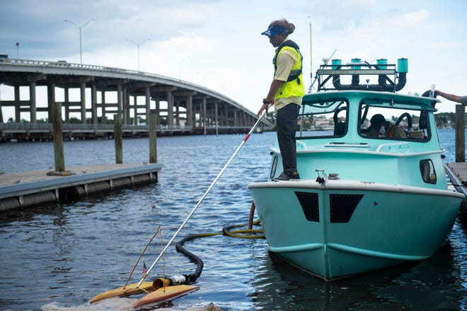 Colby Schindel, a captain at Sea Tow Treasure Coast in Jensen Beach, demonstrates a vacuum system that will be used to suck up algae blooms, during a news conference Thursday, Aug. 23, 2018, at Charlie Leighton Park in Palm City. Boca Raton-based company Aecom and Sea Tow Treasure Coast have been contracted by Martin County using a $700,000 state grant meant for algae bloom cleanup. Martin County Commissioner Ed Ciampi and Aecom Vice President of environmental services Bob Cooper spoke about the process of algae removal. Boats will use nets to concentrate the algae bloom, allowing a vacuum to suck the algae into a tank on the boat or tanker trucks parked on land. To see more photos, go to TCPalm.com.