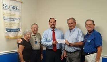 Michael Strouse, vice president, branch sales leader IV, BankUnited, presented a check for $2,500 to Ken Koziol, SCORE chapter chair; Tom Turynowicz, past president; George Greenstein, technology chair; and Ruth Fite, administrative chair, to support the Chapter's small business education and technical assistance programs.
