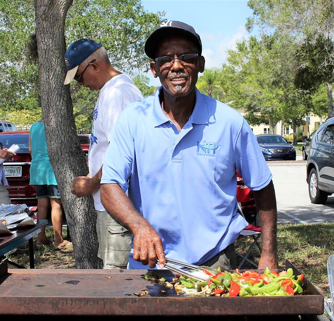 Harry Shaw preps the BBQ at last year's Junk in the Trunk event.