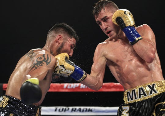 Maxim Dadashev, right, connects to the face of Jose Marrufo during their fight in August 2017.