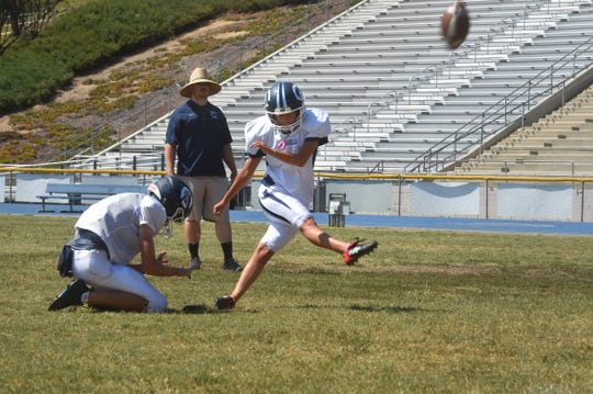 Alex Gonzalez drills a kick during a Camarillo High football practice. The soccer star made five extra-point attempts and a 30-yard field goal in her first varsity game on Aug. 17.