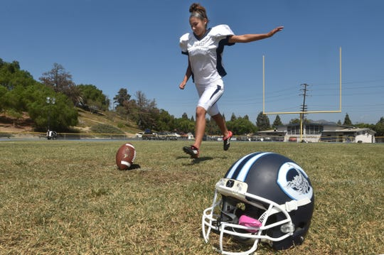Alex Gonzalez works on her kicking form during Camarillo High's football team practice. The senior is the first female kicker in program history.