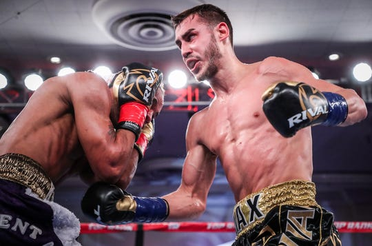 Maxim Dadashev, right, connects to the body during his fight against Jerome Rodriguez in January.
