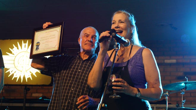 Dan and Denise Littleton say goodbye Aug. 18 at The Cellar Door.