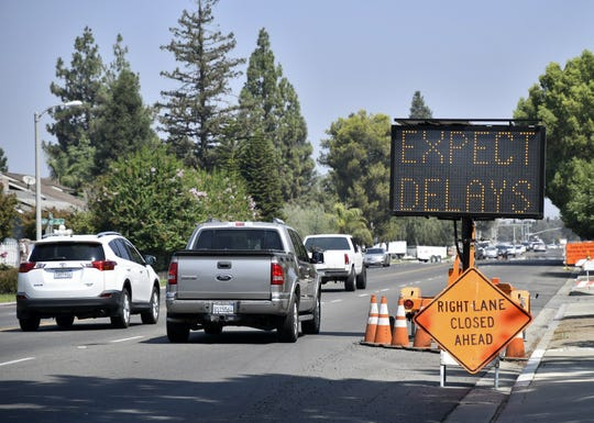 Signs alert drivers of road work near the Goshen Avenue and Demaree Street intersection on Thursday, August 23, 2018.