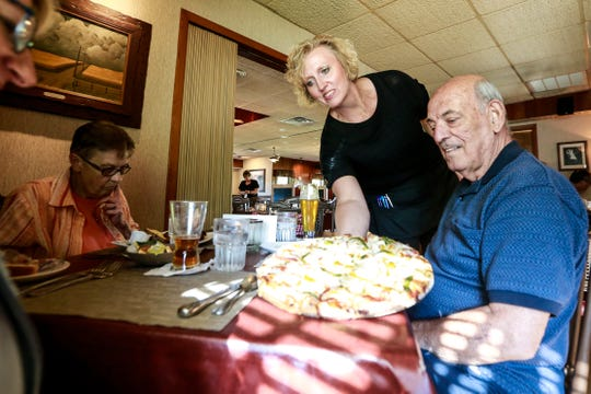 Waitress Nadene Seymour serves customer Dennis Hess Tuesday, July 24, 2018, at Two Lakes Supper Club in Almond, Wis.