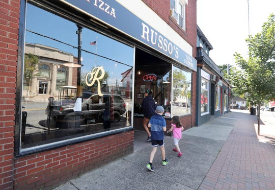 """Russo's in Pearl River, photographed Aug 23, 2018. Owner Michael Russo has created a dish he call a """"Pizzaritto"""". The Pizzaritto is a pizza that gets rolled up after the addition of ingredients such as meatballs, chicken, mozzarella sticks, spaghetti, sausage, and garlic rolls."""