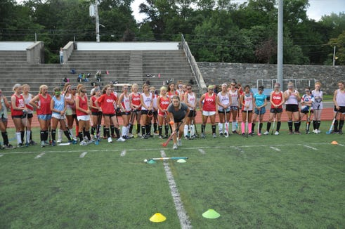 New Rye coach Lindsey Ferris demonstrates drill during tryouts this week.