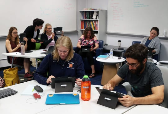 Students and teachers from Briarcliff High School listen to a representative fro Apple,  as they learn how to code, at the high school in Briarcliff Aug. 22, 2018.