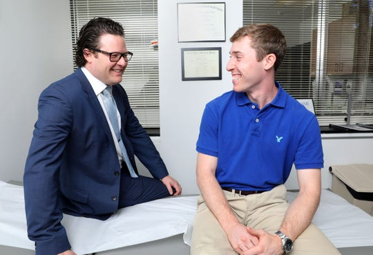Dr. Michael Gott, left, an orthopedic surgeon with White Plains Hospital, and patient Chris Ramondelli, 22, in White Plains Aug. 23, 2018. Dr. Gott performed hip arthroscopy on Ramondelli after an ice hockey injury.