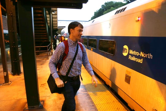 Steve Croy boards the 6:40am train to Grand Central Terminal from the Poughkeepsie Train Station on August 21, 2018.