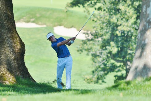 James Nicholas digs the ball out of a bad lie to the right of the 18th fairway on Thursday at Wykagyl Country Club. The Scarsdale resident got up and down from behind the green for birdie and finished in third place at 9-under.