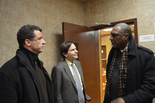 Developer Glenn Griffin, left, with Alexander Roberts and Troy DeCohen of the Interfaith Coalition for Social Change at Buchanan Village hall in 2016.