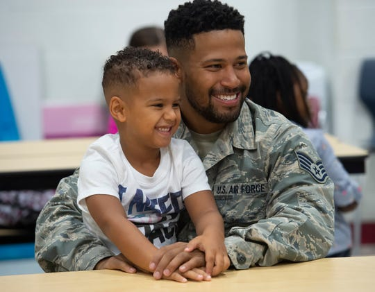 Staff Sgt. Joseph DuBois and his son Zy'Are DuBois, 5, at the Boo Hoo Breakfast on the first day of school at South Dover Elementary.