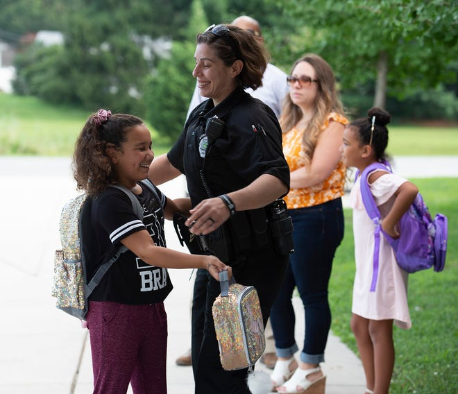 Students are welcomed back on the first day of school at South Dover Elementary in Dover.
