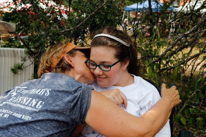Kathleen Harris gives Scedra Stoffel a kiss on the cheek on Sunday, August 19, 2018, after giving her a piece of jewelry as a token of Harris' gratitude to Stoffel for being the ambassador for Jeremiah's Crossing, a non-profit therapeutic horseback-riding ranch run by Harris in Babcock, Wis.