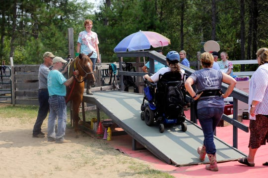 Scedra Stoffel rides up the wheelchair ramp as she prepares to get on to Alan, the horse she regularly rides at Jeremiah's Crossing during their ride-a-thon event Sunday, August 19, 2018 in Babcock, Wis.