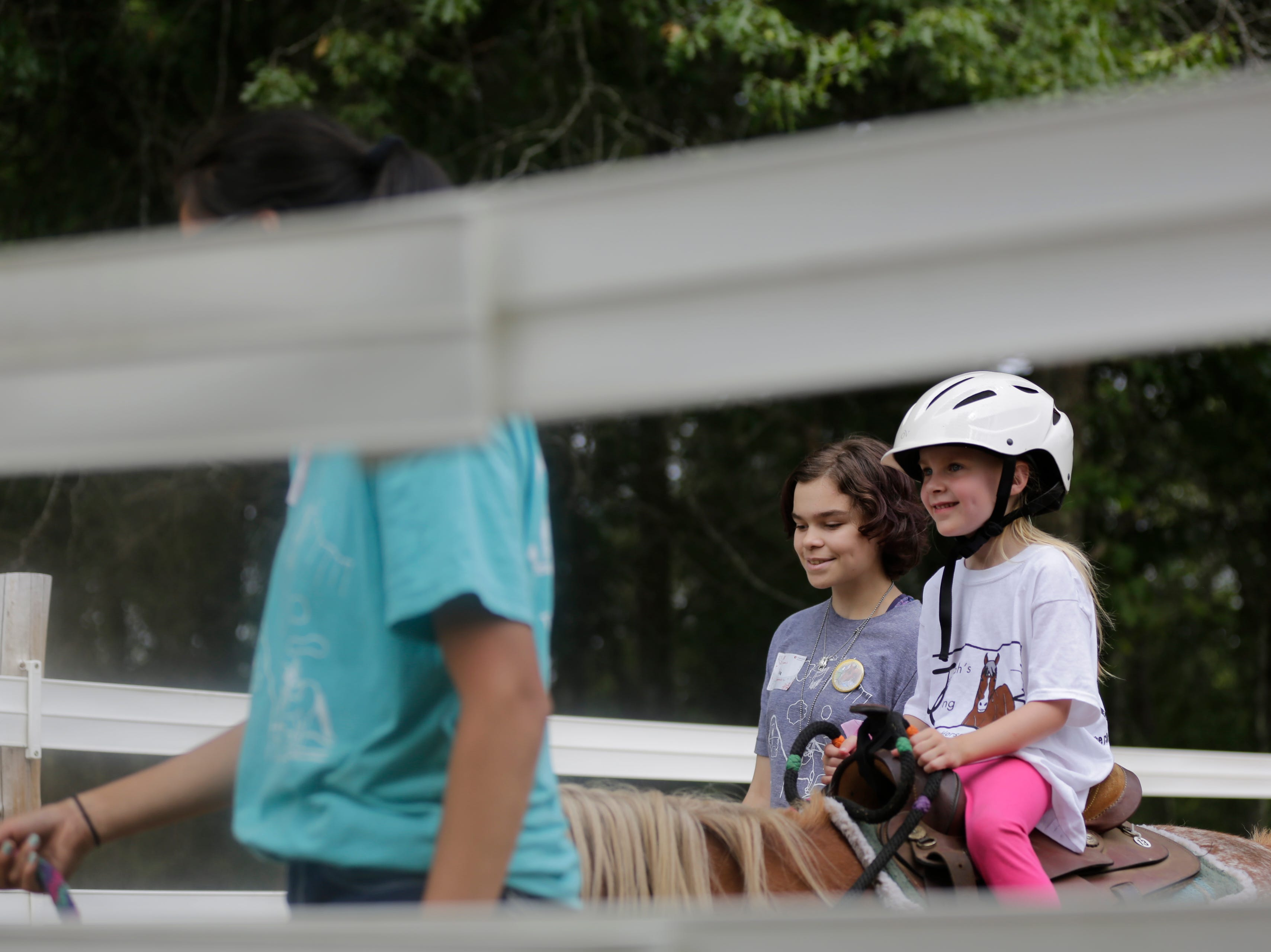 Ellie Budtke, 5, rides Jazzy the horse during the Jeremiah's Crossing ride-a-thon Sunday, August 19, 2018.