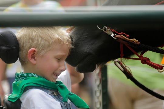 Jack the horse gives Waylon Budtke, 7, a nudge after Budtke's ride with Jack during the Jeremiah's Crossing ride-a-thon event Sunday, August 19, 2018 in Babcock, Wis.