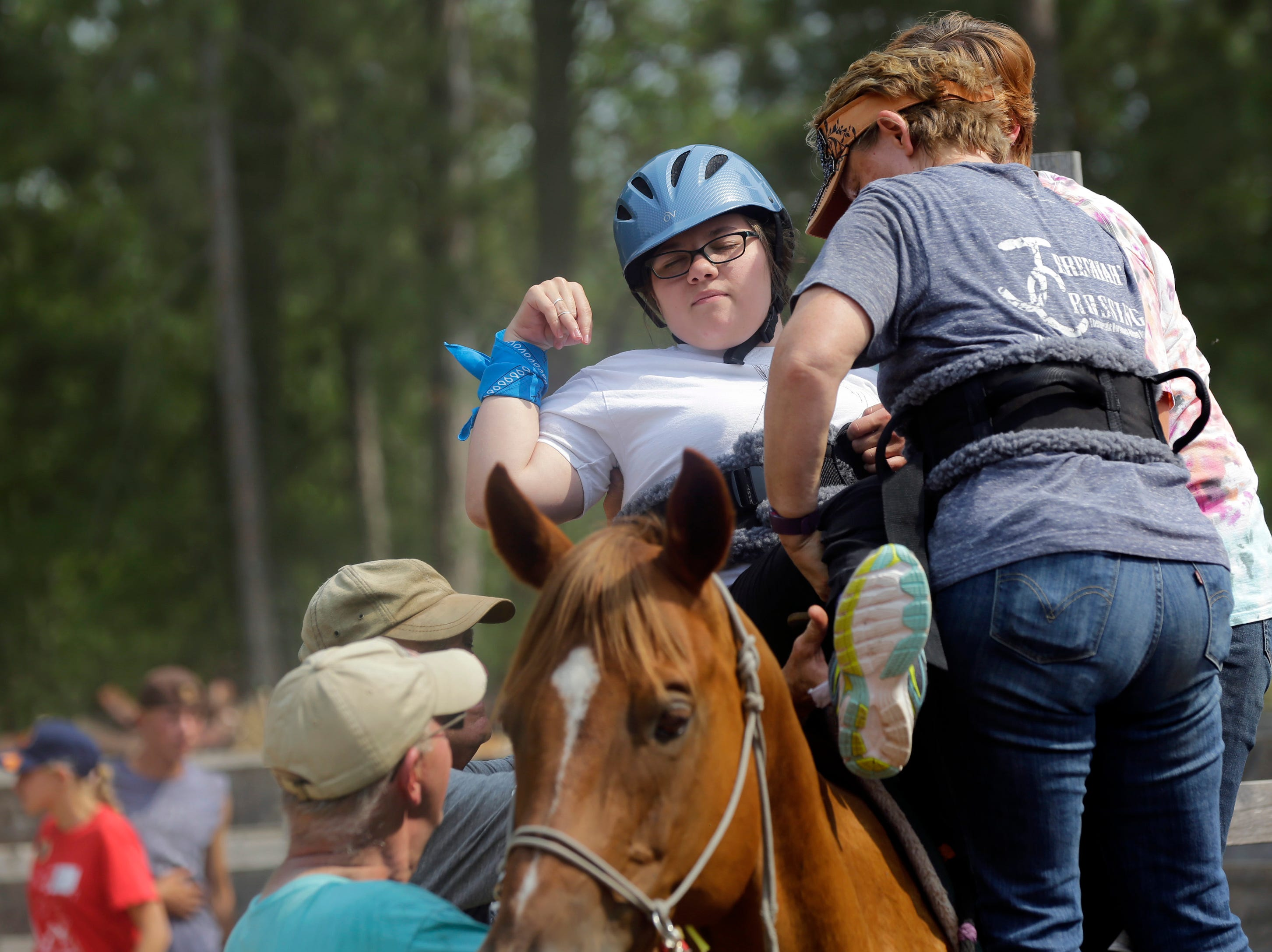 Scedra Stoffel is helped onto Alan the horse by Kathleen Harris and three volunteers during the Jeremiah's Crossing ride-a-thon event Sunday, August 19, 2018 in Babcock, Wis.