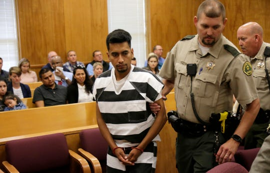Cristhian Bahena Rivera is lead into the courtroom for his initial court appearance, Wednesday, Aug. 22, 2018, at the Poweshiek County Courthouse in Montezuma, Iowa. Rivera is charged with first-degree murder in the death of Mollie Tibbetts, who disappeared July 18 from Brooklyn, Iowa.