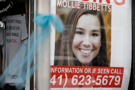 A poster for missing University of Iowa student Mollie Tibbetts hangs in the window of a local business, Tuesday, Aug. 21, 2018, in Brooklyn, Iowa. Tibbetts was reported missing from her hometown in the eastern Iowa city of Brooklyn in July 2018.
