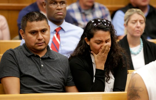 People in the courtroom reacts after Cristhian Bahena Rivera's initial court appearance, Wednesday, Aug. 22, 2018, at the Poweshiek County Courthouse in Montezuma, Iowa. Rivera is charged with first-degree murder in the death of Mollie Tibbetts, who disappeared July 18 from Brooklyn, Iowa.