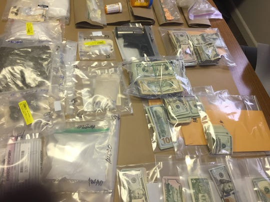 More than $200,000 in drugs, cash and firearms were seized during a drug sweep at several locations on Aug. 7