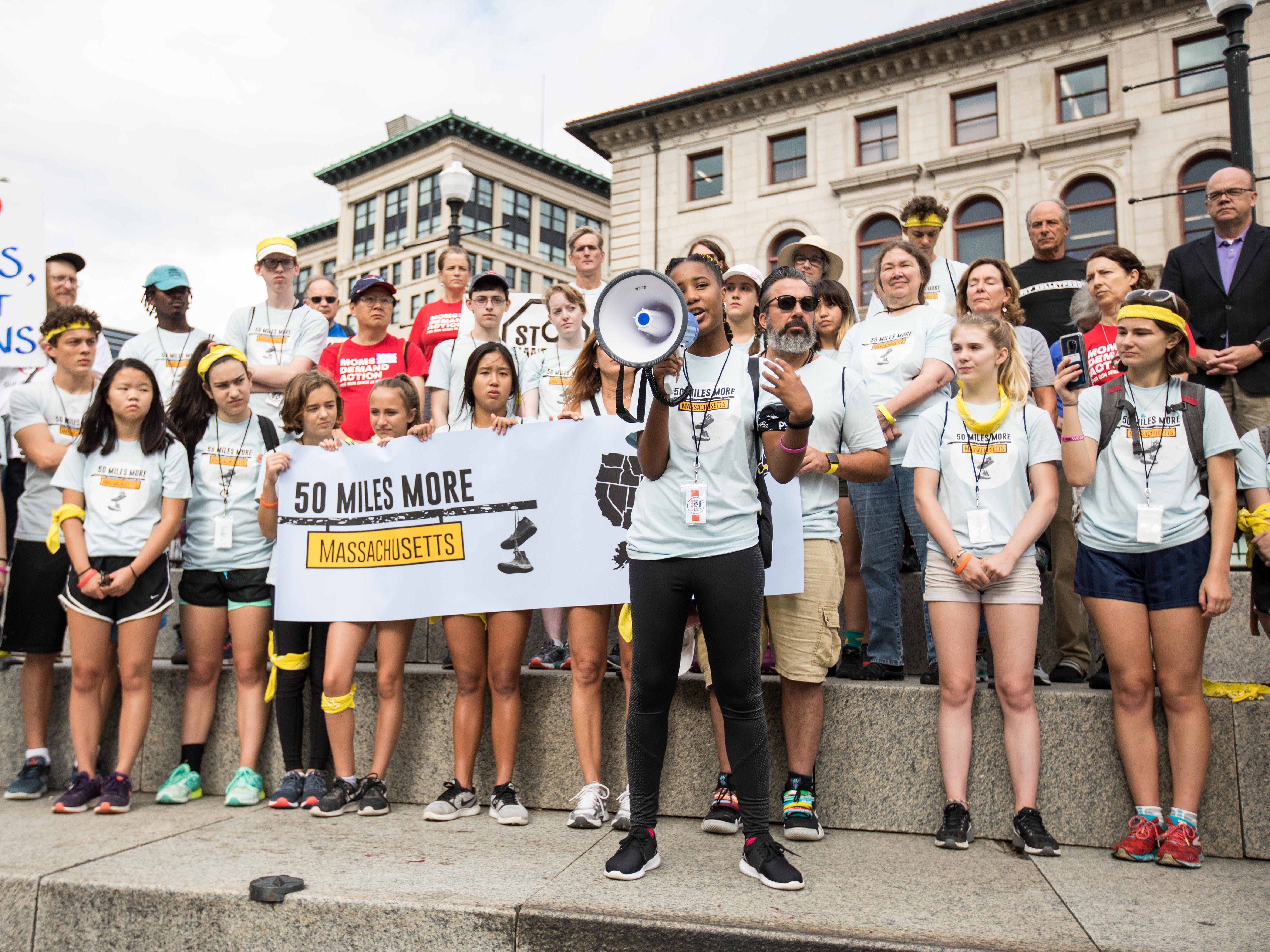 Activists take part in the 50 Miles More walk against gun violence gather at Worcester City Hall on Aug. 23, 2018 in Worcester, Mass.