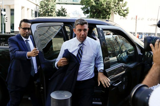 U.S. Rep. Duncan Hunter, center, arrives for an arraignment hearing Thursday, Aug. 23, 2018, in San Diego. Hunter and his wife were indicted Tuesday on federal charges that they used more than $250,000 in campaign funds for personal expenses that ranged from groceries to golf trips and lied about it in federal filings, prosecutors said.