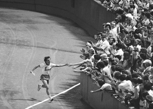 On Aug. 29, 1978, Dave McGillivray reaches out to fans at Fenway Park as he completes a 3,400-mile, 80-day cross country run.
