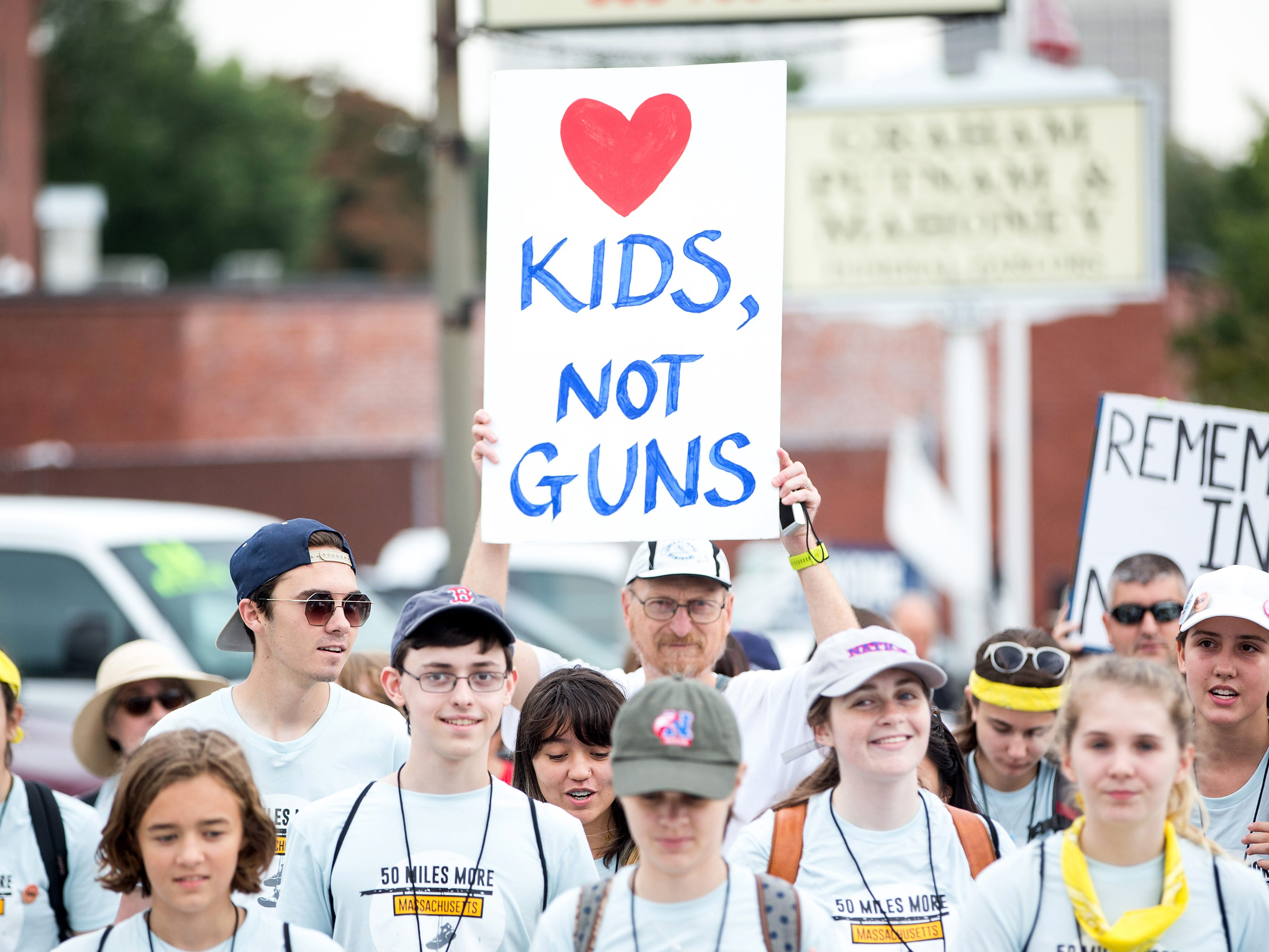 Parkland Shooting survivor and activist David Hogg, third from left, walks during the 50 Miles More walk against gun violence which will end with a protest at the Smith and Wesson Firearms factory on Aug. 23, 2018 in Worcester, Mass. After the Parkland, Florida mass shooting, 50 Miles More was organized to engage young people in the effort to bring about gun reform legislation.