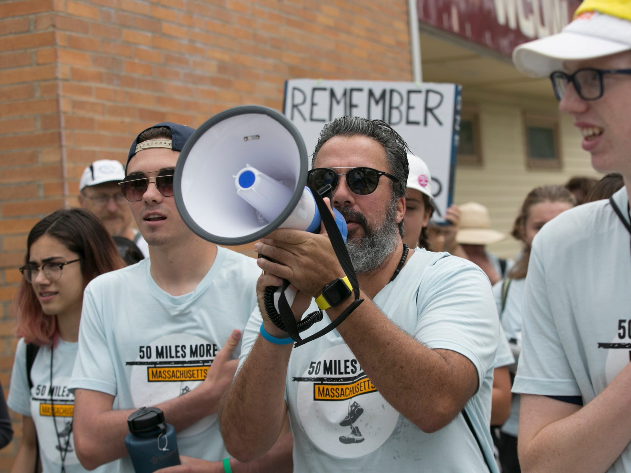 David Hogg, second from left, 18, a survivor of the Valentine's Day 2018 Parkland shooting and a resident of Parkland, Florida, is joined by Manuel Oliver. center, 50, father of murdered Parkland shooting victim Joaiquim Oliver, at a youth march to protest gun violence, in Worcester, Mass. on Aug. 23, 2018. More than 50 youth activists prepared to march 50 miles to the Smith & Wesson's headquarters in Springfield, Mass to stress their call on the gun manufacturer to stop manufacturing all weapons outlawed under Massachusetts' 2004 Assault Weapons Ban and to make a five million US dollars donation towards researching gun violence.