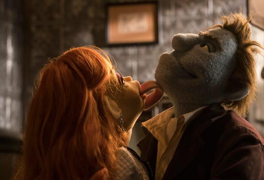 "Sandra puts the moves on private eye Phil in ""The Happytime Murders."""