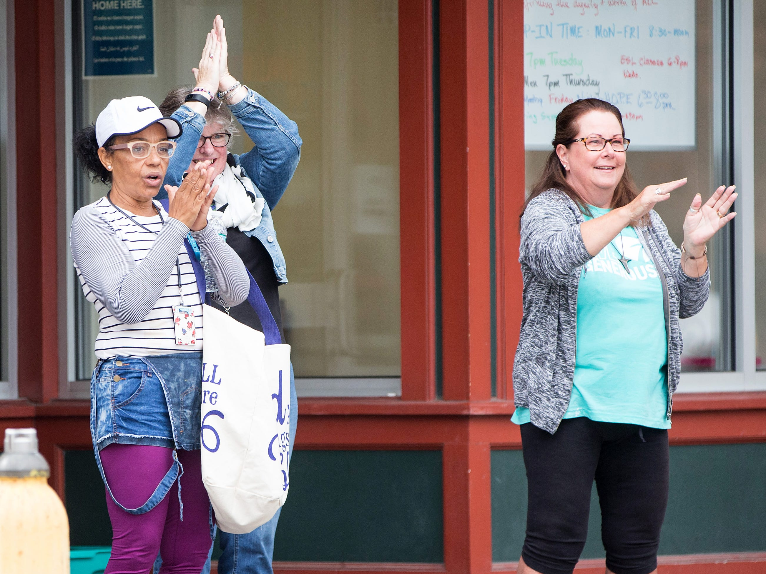 Onlookers applaud as the 50 Miles More walk against gun violence passes by on Aug. 23, 2018 in Worcester, Mass.