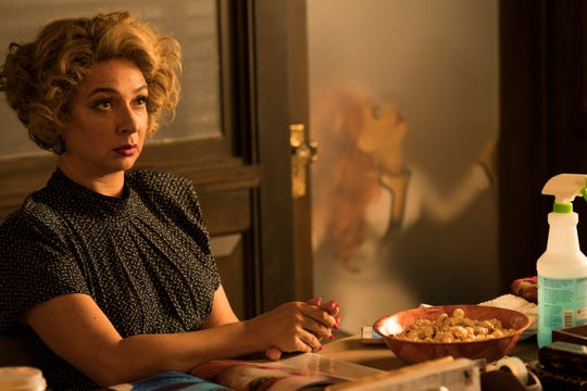 """Maya Rudolph (as receptionist Bubbles) tries to ignore the activity in the office next door in """"The Happytime Murders."""""""
